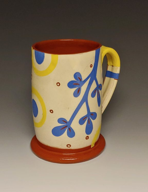 Cheerful Mug with Blue Branch Dots and Yellow Rings