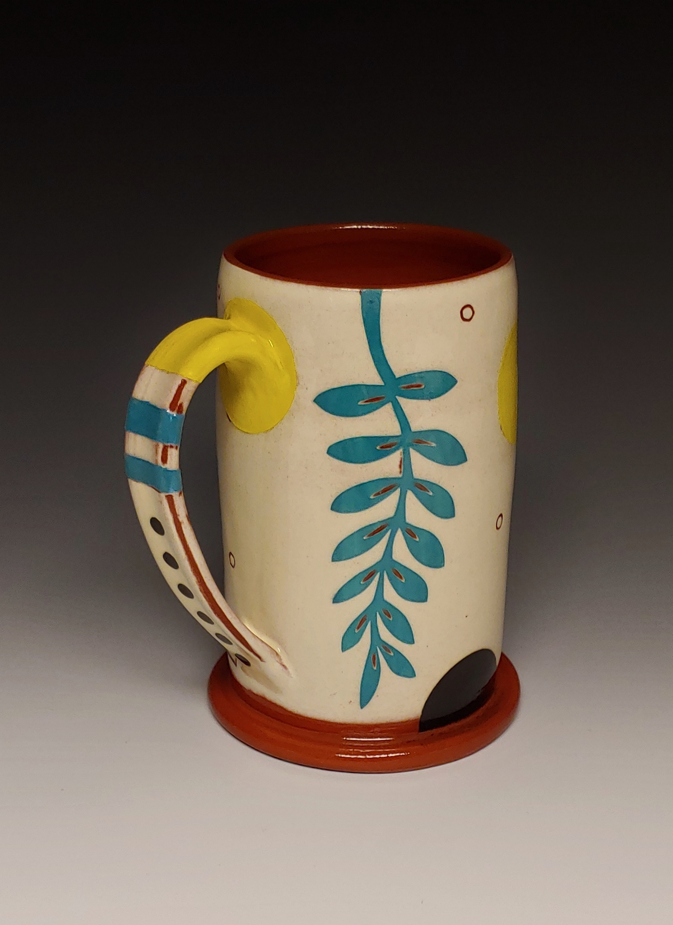 Cheerful Mug with Turquoise Leaf Dots and Tube Sock Stripes