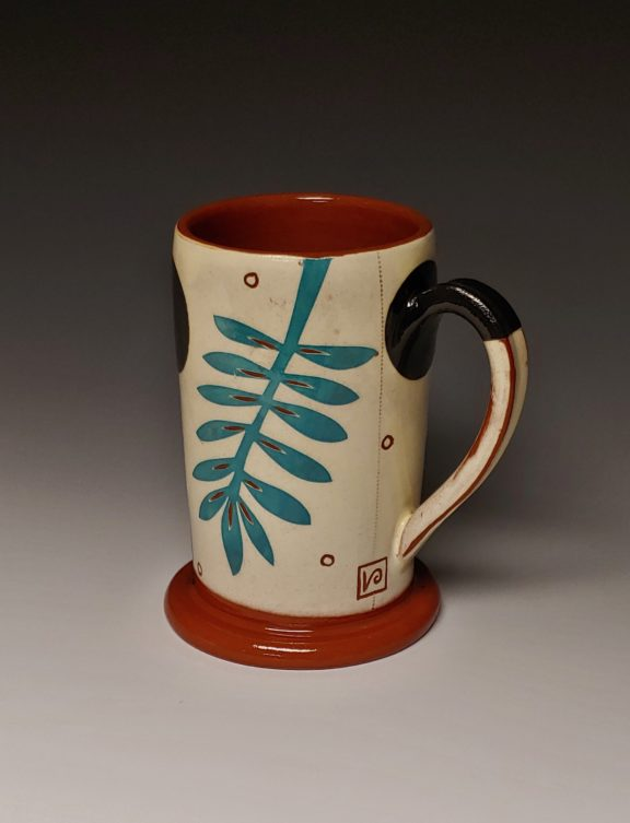 Cheerful Turquoise Leafy Mug with Black Spots