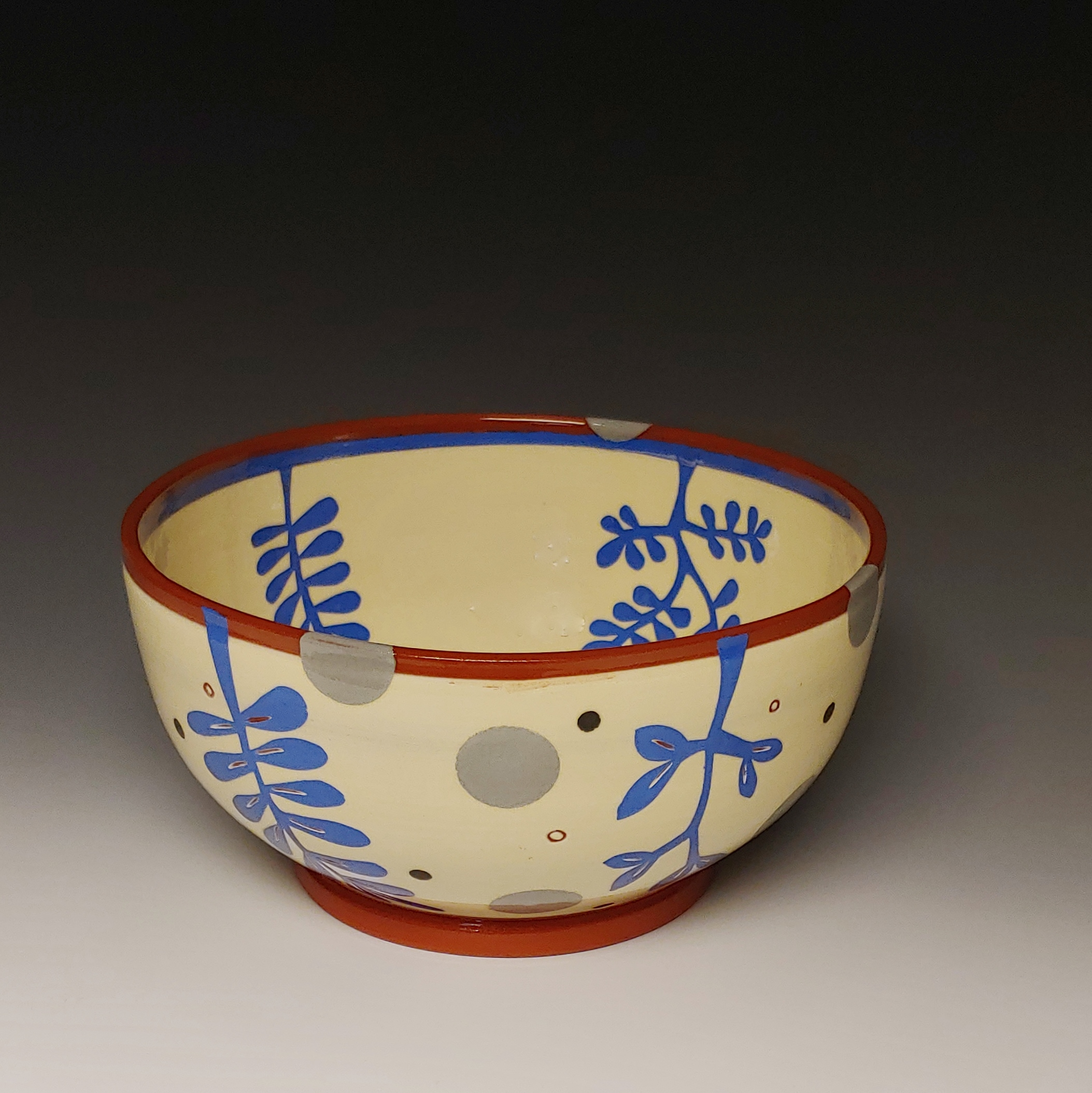 Medium Serving Bowl with Blue Leafy Cutouts and Gray Spots Throughout