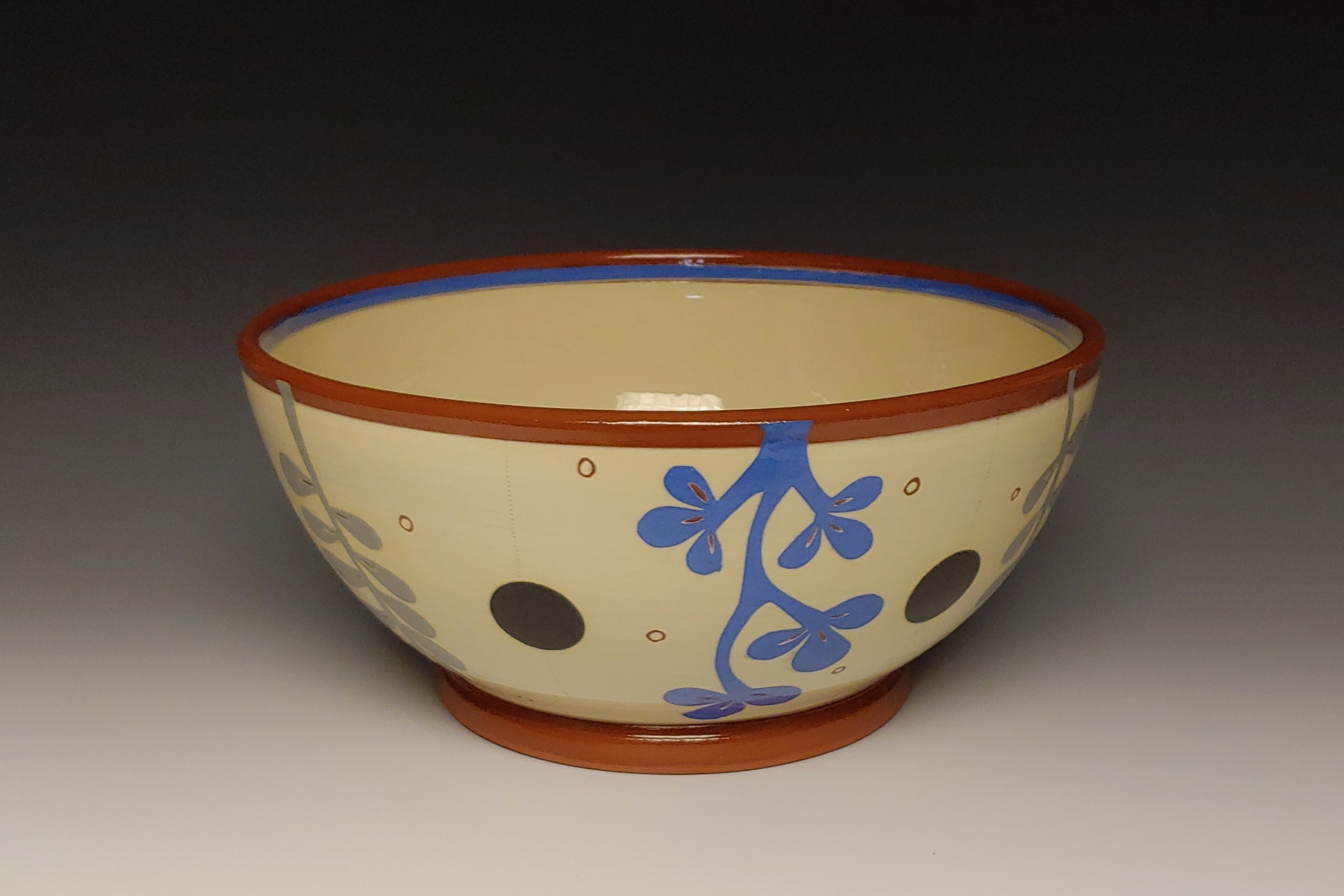 Medium Serving Bowl with Blue and Gray Leafy Cutouts Interiour Blue Band and Black Spots