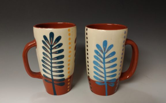 Two Tall Mugs with Leafy Cutouts and Dots