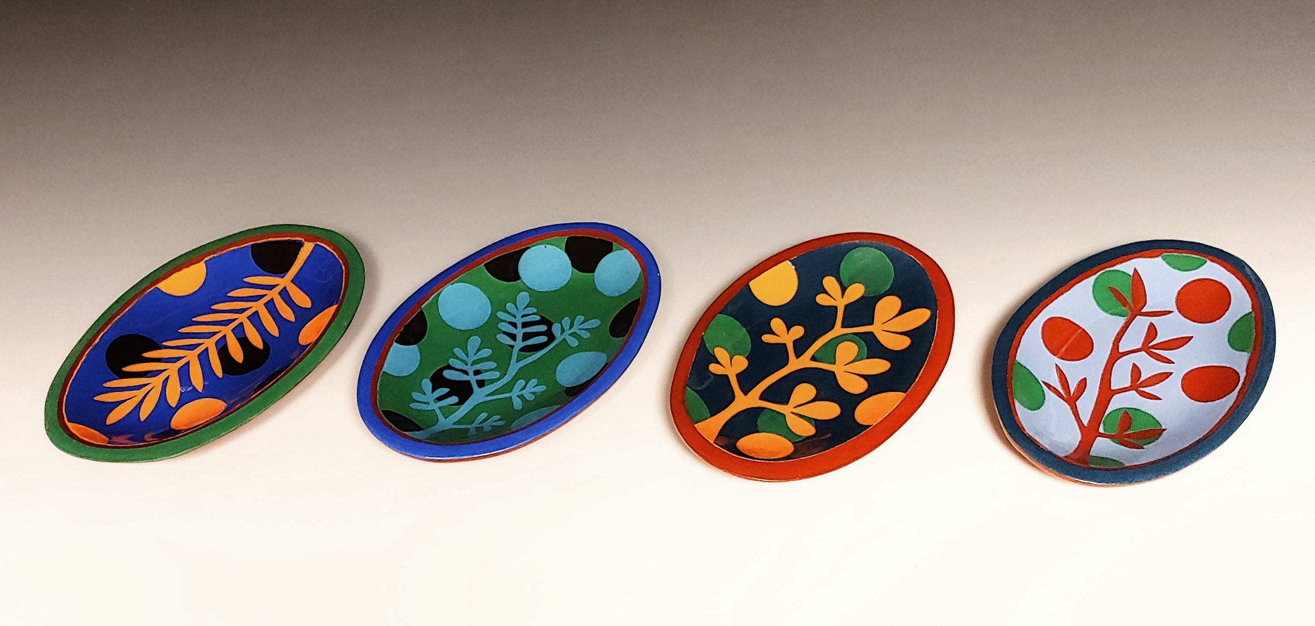 Four Mini Oval Leafy Colorful Dishes