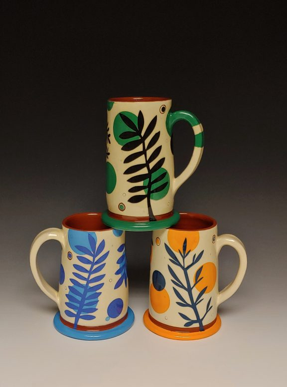 Three Cheerful Steins Stacked