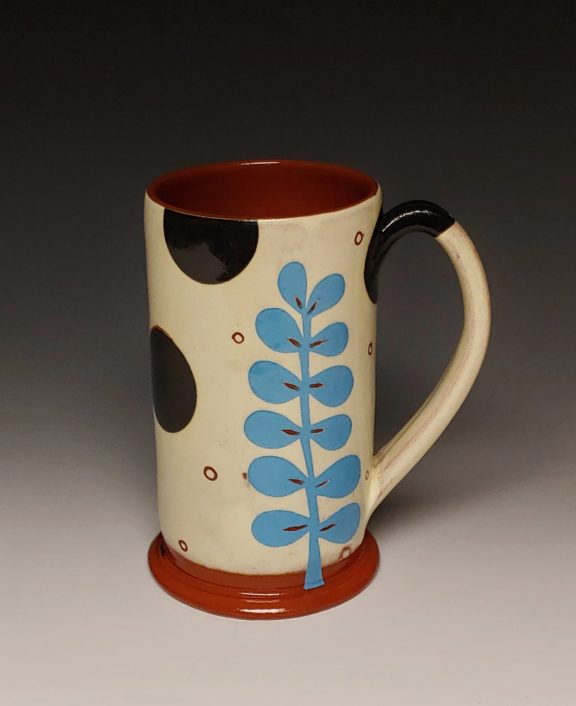 Cheerful Mug with Turquoise Leaf and Black Spots