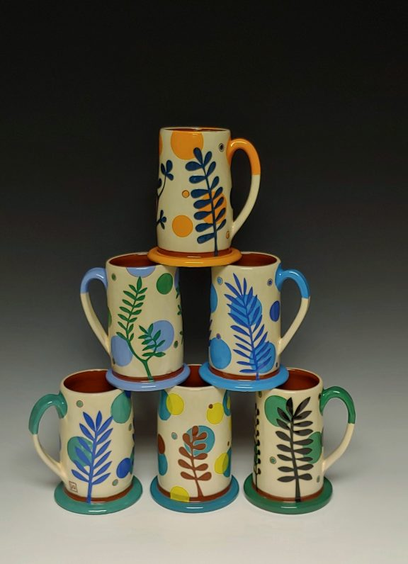 Six Stacked Colorful mugs