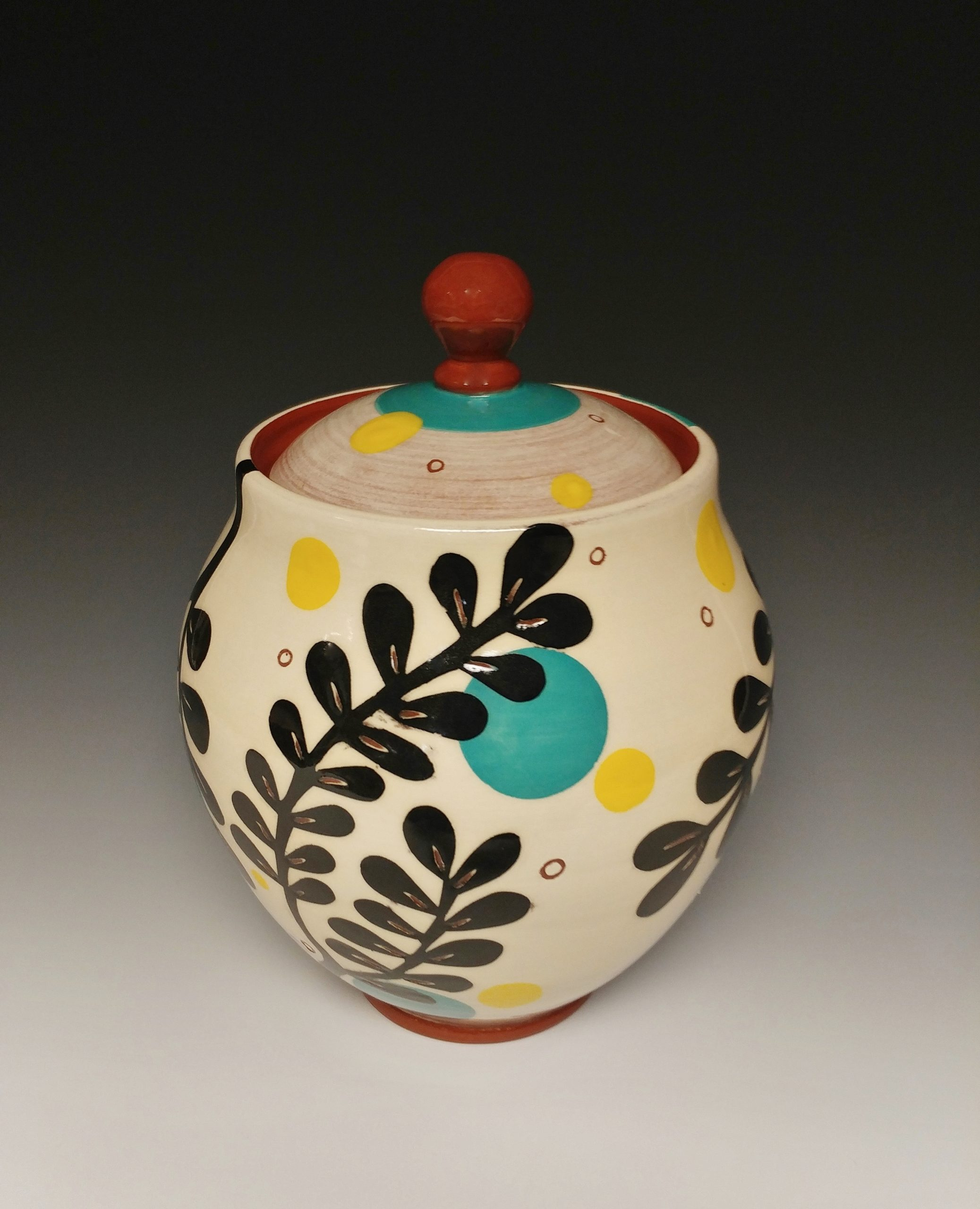 Leafy Lidded Jar with Black Cutouts and Yellow Dots
