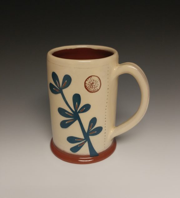 Leafy Mug with Blue Plant and Carved Orb