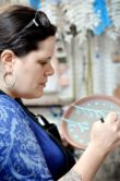 Rebecca May Verrill carving a plate